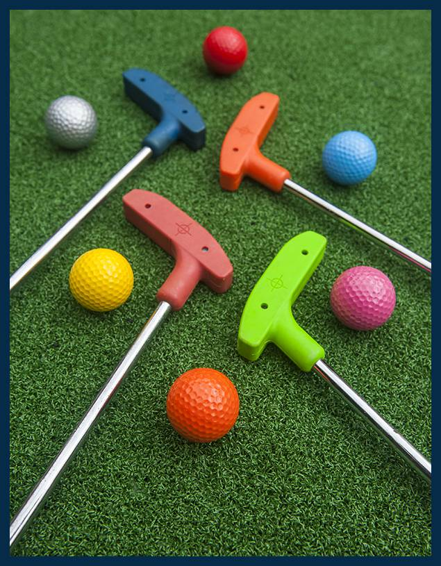 Golf balls and putters